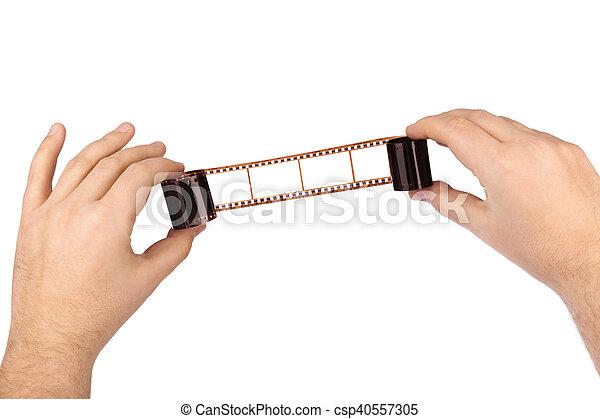 Photographic film in hands - csp40557305