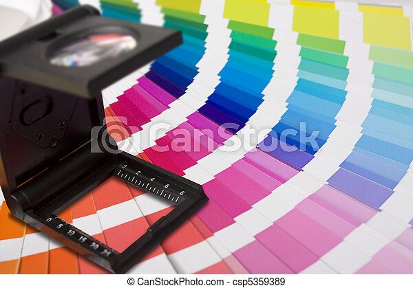 photographic magnifying lupe and colour swatches - csp5359389
