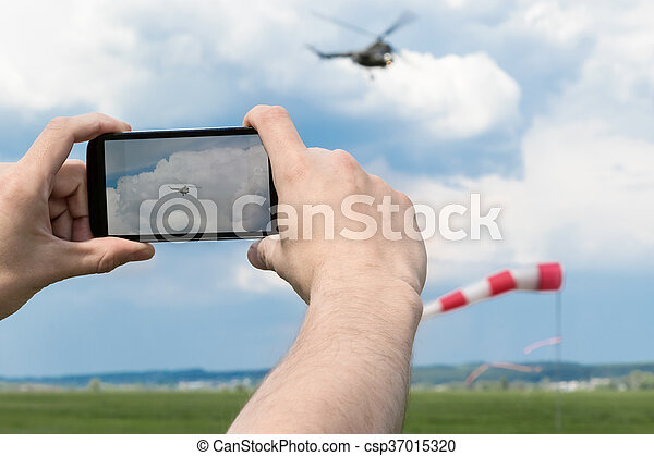 Photographing the helicopter on a smartphone - csp37015320