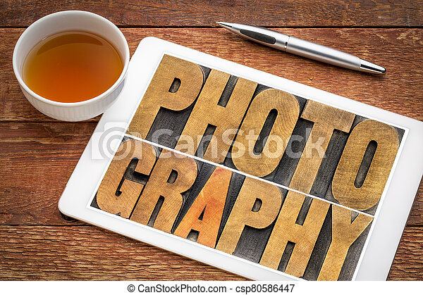 photography word abstract in vintage letterpress wood type - csp80586447