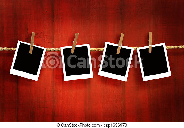 Photos frames on rustic red wood background - csp1636970