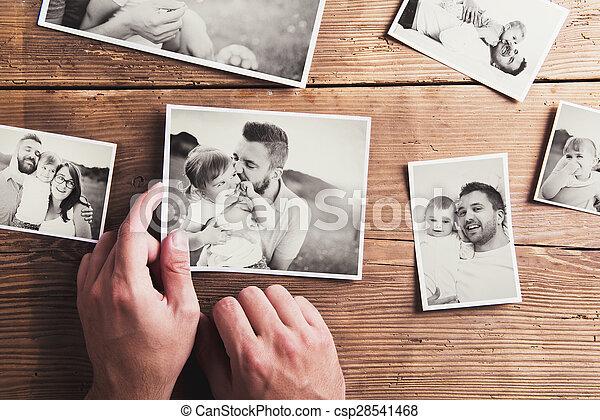 Photos on a table - csp28541468