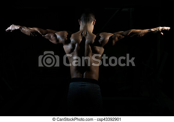 Physically Man Showing His Well Trained Back - csp43392901