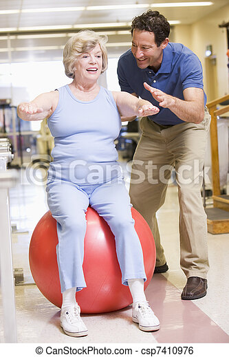Physiotherapist With Patient In Rehabilitation - csp7410976