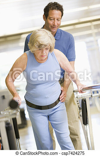 Physiotherapist With Patient In Rehabilitation - csp7424275