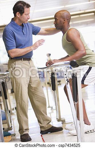 Physiotherapist With Patient In Rehabilitation - csp7434525