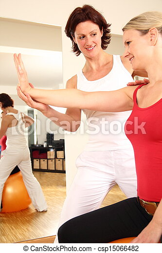 Physiotherapist working on arm shoulder nack pain - csp15066482