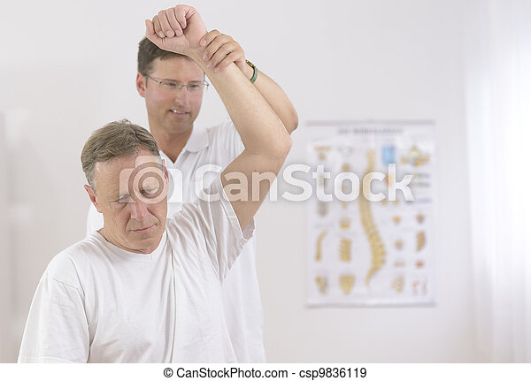 Physiotherapy: Senior man and physiotherapist - csp9836119