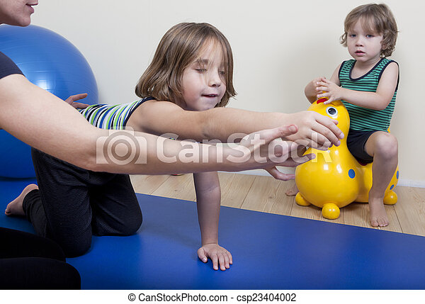 Physiotherapy with two children - csp23404002