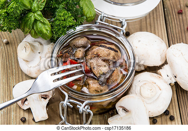 Pickled mushrooms in a glass - csp17135186