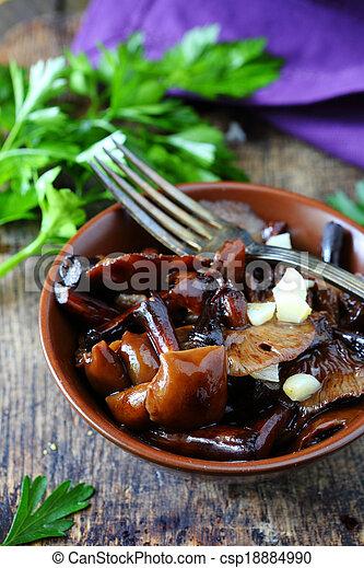 pickled mushrooms in a salad - csp18884990