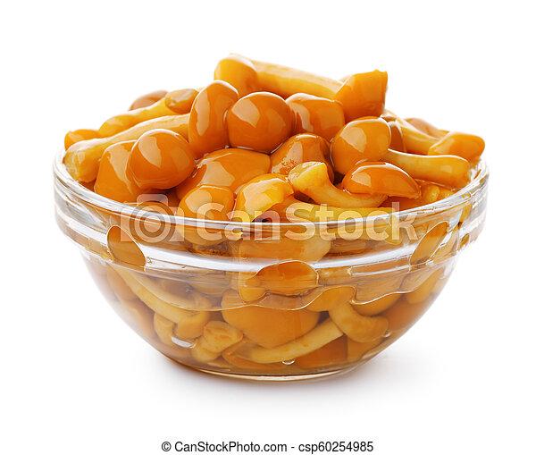 Pickled mushrooms in glass bowl - csp60254985
