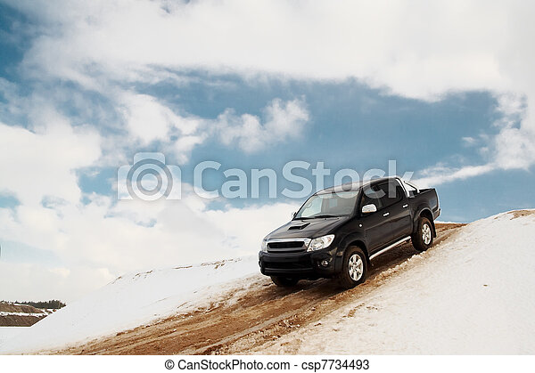 Pickup truck driving down the hill - csp7734493