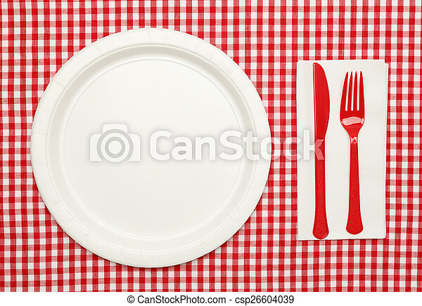 Picnic table setting. Paper plate on red checkered table... stock ...
