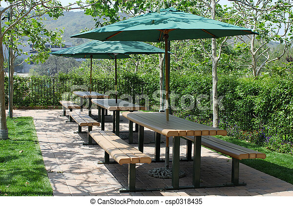 Great Picnic Tables With Umbrellas Stock Photo
