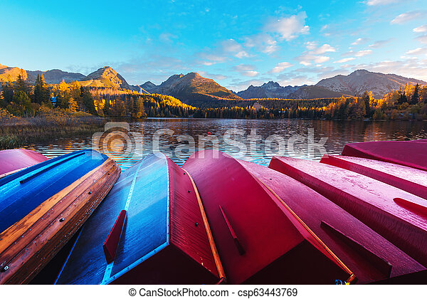 Picturesque autumn view of lake Strbske pleso in High Tatras National Park - csp63443769