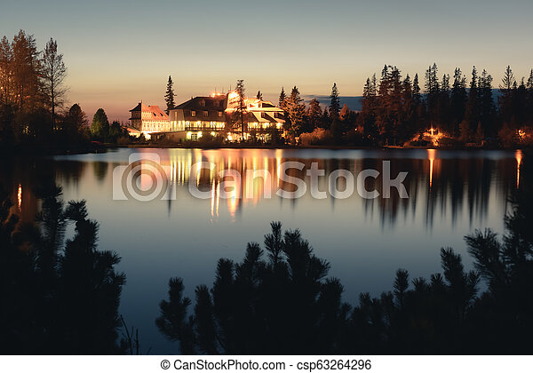 Picturesque autumn view of lake Strbske pleso in High Tatras National Park - csp63264296