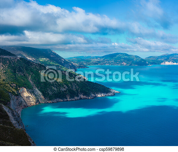 Picturesque rocky coastline on Kefalonia island. Amazing landscape with cloudscape and shadows on sea surface. Greece - csp59879898