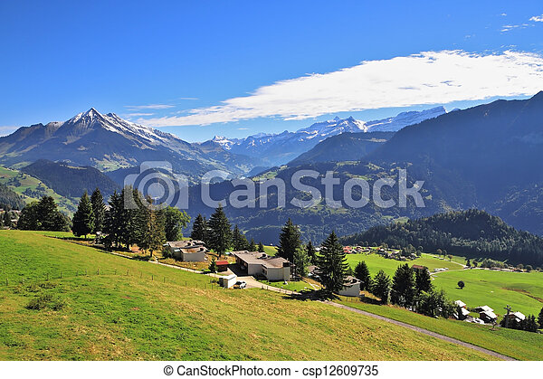 Picturesque rural houses chalets with red roofs - csp12609735
