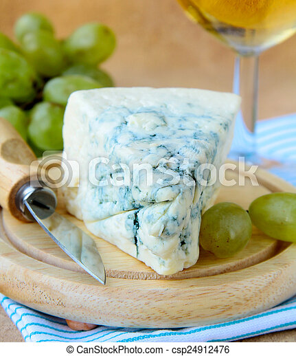 piece of blue cheese with fruits - csp24912476