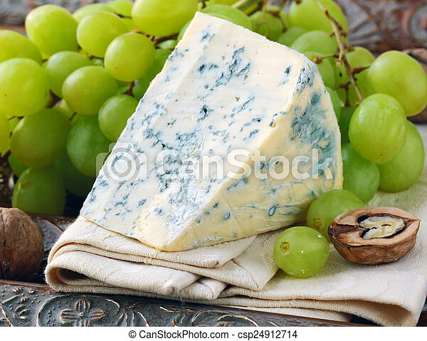 piece of blue cheese with fruits - csp24912714