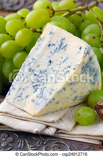 piece of blue cheese with fruits - csp24912716