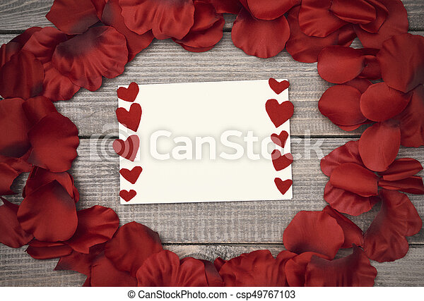 Piece of paper in the circle of petals - csp49767103