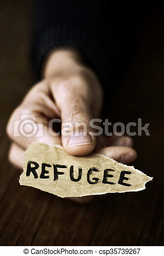 piece of paper with the word refugee - csp35739267