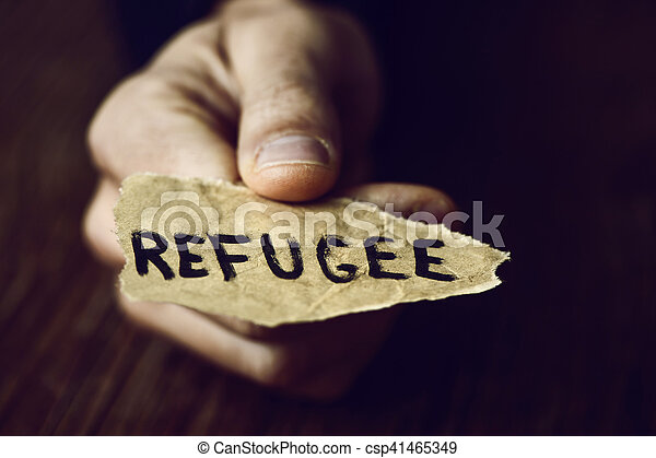 piece of paper with the word refugee - csp41465349