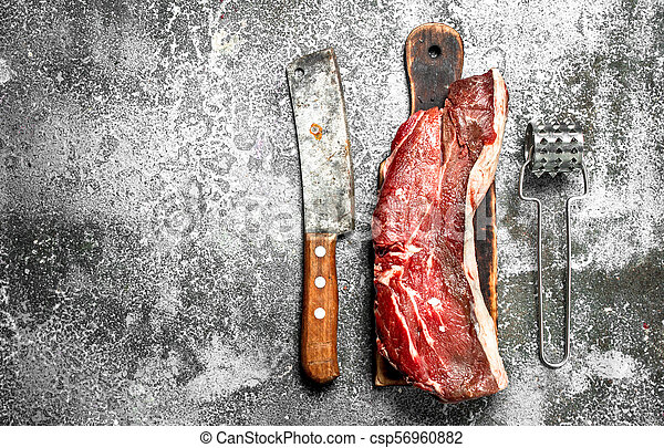 piece of raw beef. - csp56960882