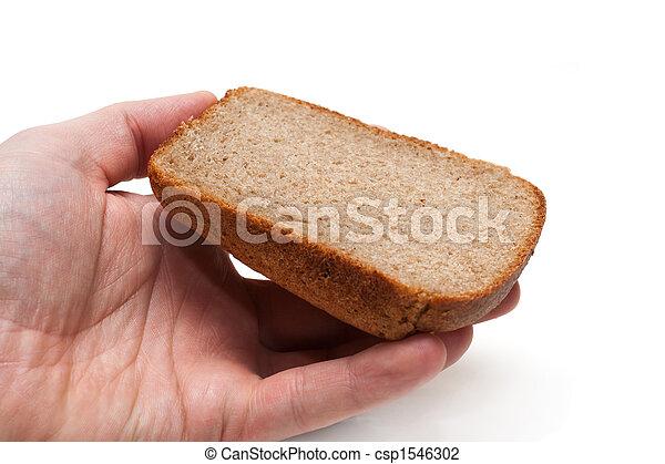 Piece of the pumpernickel in hand - csp1546302