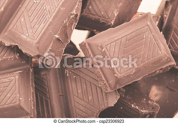Pieces of milk chocolate - csp23306923