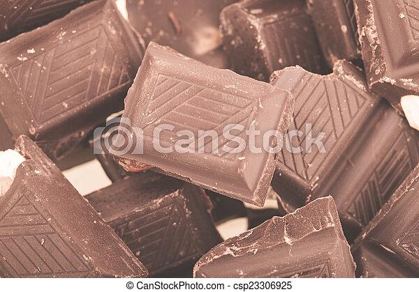 Pieces of milk chocolate - csp23306925