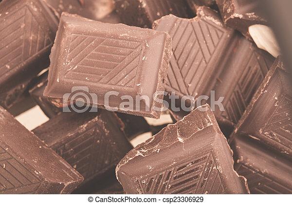Pieces of milk chocolate - csp23306929
