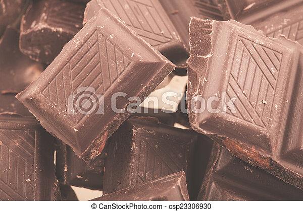 Pieces of milk chocolate - csp23306930
