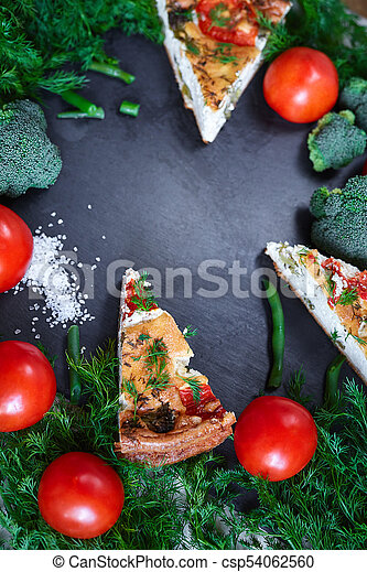 pieces of vegetable pie with cottage cheese, tomatoes, dill and asparagus beans on a dark ceramic background. - csp54062560