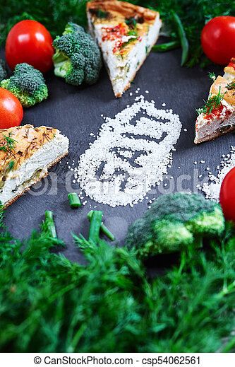 pieces of vegetable pie with cottage cheese, tomatoes, dill and asparagus beans on a dark ceramic background. - csp54062561