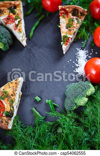 pieces of vegetable pie with cottage cheese, tomatoes, dill and asparagus beans on a dark ceramic background. - csp54062555
