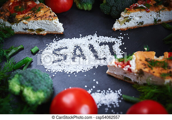 pieces of vegetable pie with cottage cheese, tomatoes, dill and asparagus beans on a dark ceramic background. - csp54062557