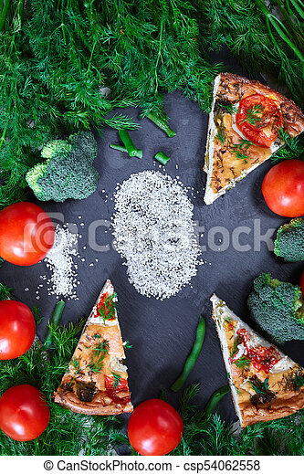 pieces of vegetable pie with cottage cheese, tomatoes, dill and asparagus beans on a dark ceramic background. - csp54062558