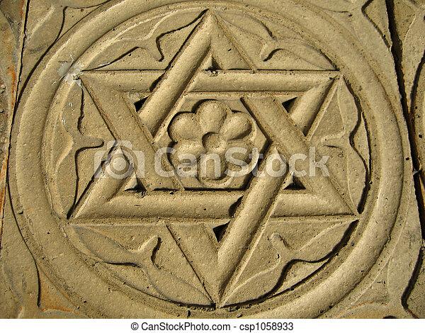 Estrella de David grabada en piedra - judaísmo - csp1058933
