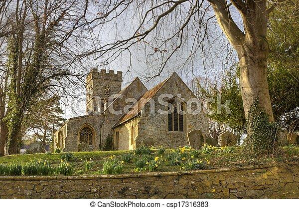 Iglesia de piedra en primavera - csp17316383