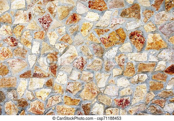 Muro de piedras con un patrón irregular de textura - csp71188453