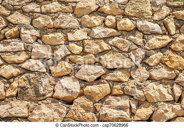 Muro de piedras con un patrón irregular de textura - csp70628966
