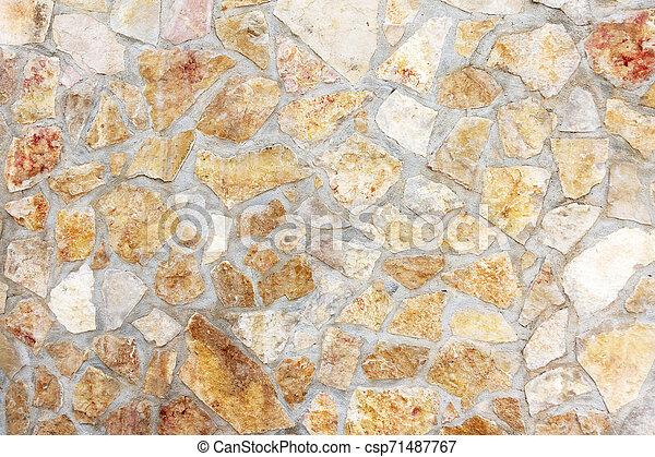 Muro de piedras con un patrón irregular de textura - csp71487767