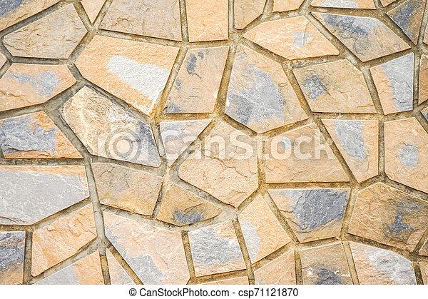Muro de piedras con un patrón irregular de textura - csp71121870