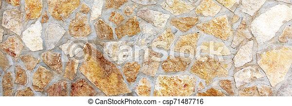 Muro de piedras con un patrón irregular de textura - csp71487716