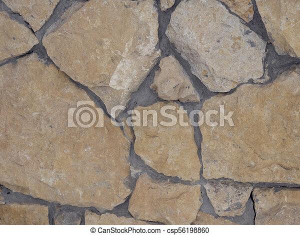 Muro de piedras de granito con un patrón irregular, textura sin costura - csp56198860