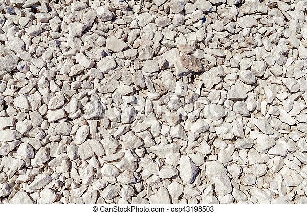 Antecedentes con piedras de mármol blanco - csp43198503