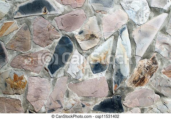 Muro de masones con piedras de forma irregular - csp11531402